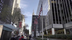 American Flags waving on 34th Street with Empire State Building in background NY Stock Footage