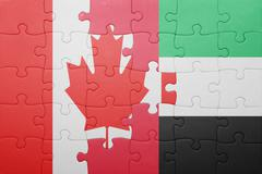 puzzle with the national flag of united arab emirates and canada - stock photo