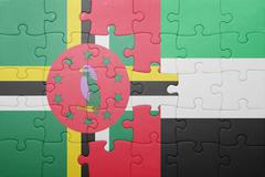 puzzle with the national flag of united arab emirates and dominica - stock photo
