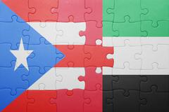 Puzzle with the national flag of united arab emirates and puerto rico Stock Photos