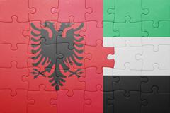 puzzle with the national flag of united arab emirates and albania - stock photo