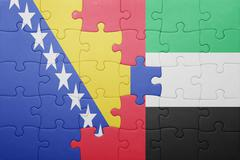 Stock Photo of puzzle with the national flag of united arab emirates and bosnia and herzegov