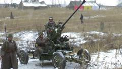 Antiaircraft gun squad ready to attack - stock footage