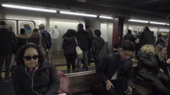 New York City passengers wait platform subway train doors to open entering - stock footage