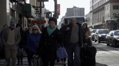 New Yorkers and tourists walking on crowded street, 8th avenue in Manhattan NYC  Stock Footage