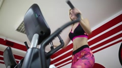 Beautiful sporty woman doing exercises on the simulator. Abdominal muscles - stock footage