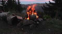 Camp fire with high mountain landscape Stock Footage