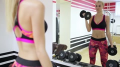 Beautiful sporty woman doing exercises with dumbbells. Abdominal muscles. Bright Stock Footage