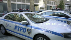NYPD police cars parked on the street outside precinct in Manhattan NYC in 1080 Stock Footage