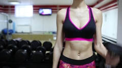 Beautiful sporty woman doing exercises with dumbbells. Abdominal muscles. Bright - stock footage