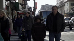 People walking in slow motion on crowded street, 8th avenue in Manhattan NYC Stock Footage