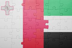 Stock Photo of puzzle with the national flag of united arab emirates and malta