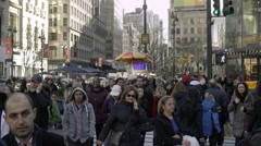 Racially diverse crowded busy street with hot dog vendors and tourists walking Stock Footage