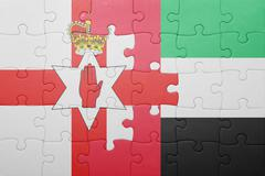 Puzzle with the national flag of united arab emirates and northern ireland Stock Photos