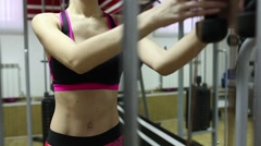 Stock Video Footage of Beautiful sporty woman doing exercises on the simulator. Abdominal muscles