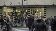 Shoppers crossing on 34th street crosswalk with Sephora storefront entrance NYC Stock Footage