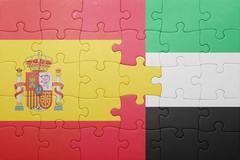 Puzzle with the national flag of united arab emirates and spain Stock Photos