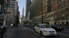 White Honda Accord driving across 34th street Empire State Building NYC Stock Footage
