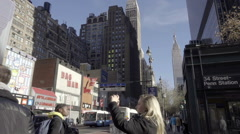 Tourist taking a picture on Midtown Manhattan with Empire State Building Stock Footage