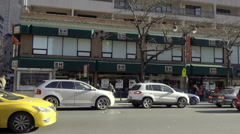 B&H Photo Superstore on 9th Ave in Manhattan with taxi cabs and cars driving Stock Footage
