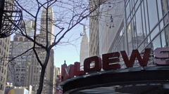 zooming in on Empire State Building from over Loews cinema movie theater in NYC - stock footage