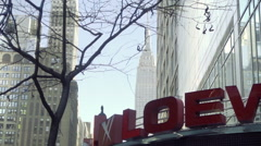 Zooming out from Empire State Building over the Loews movie theater on 34th St Stock Footage