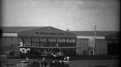 Stock Video Footage of 1935: Pan American Airways System airplane warehouse hangars.  MIAMI, FLORIDA