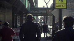 People walking in slow motion silhouettes outside B and H Photo on 9th Ave NYC Stock Footage