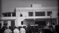 1935: People walking to the Pan American Airways System building. MIAMI, FLORIDA - stock footage