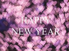Christmas and New Year greeting card on pink heart light bokeh background - stock photo