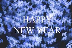 Christmas and New Year greeting card on blue butterfly light bokeh background Stock Photos