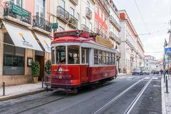 Historic yellow tram in front of the Lisbon - stock photo
