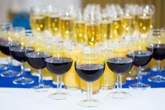Glasses with champagne on the party table. lot of alcohol Stock Photos