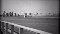 1935: Horse race closeup from guardrail of fast thorobreds approaching. HIALEAH, Stock Footage