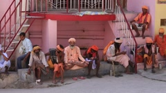Poor men sits on ghat along  Ganges river. Rishikesh, India Stock Footage