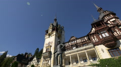 King Carol I statue in front of Peles Castle - stock footage