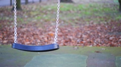 Plastic swing at the playground Stock Footage