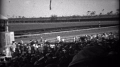 1935: Crowd at horse track race watching horses come out to compete. HIALEAH, Stock Footage