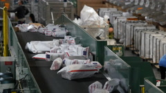 US Post office packages on the sorting line Stock Footage