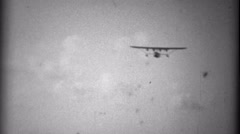 1935: Pan Am Sikorsky S-40 sesquiplane amphibious flying boat landing to crowd. Stock Footage
