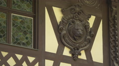 Stained glass window and carved wood on the facade of Peles Castle Stock Footage