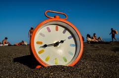 Clock on the Sand Beach Kuvituskuvat