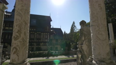 Sculpted columns and a statue on the terrace of Peles Castle Stock Footage