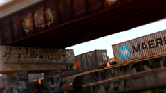 Rusting Graffiti covered overpass and Train Bridge as freight train passes - stock footage