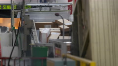 Stock Video Footage of US post office packages on a conveyor belt