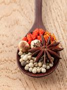 Spices in wooden spoon saffron, matrimony vine(chinese wolfberry),star anise Stock Photos