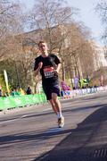 LONDON - APRIL 13: Unidentified children run the London marathon on April 13t - stock photo