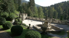 Beautiful terrace with fountain and statues at Peles Castle Stock Footage
