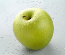 Wet Granny Smith Apple. - stock photo
