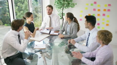 4K Corporate business team brainstorming for ideas in office meeting. - stock footage